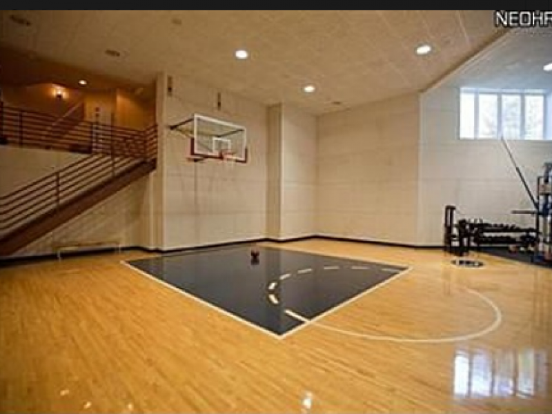 Nba 39 s calvin booth 39 s avon lake mansion for sale includes for Home indoor basketball court cost
