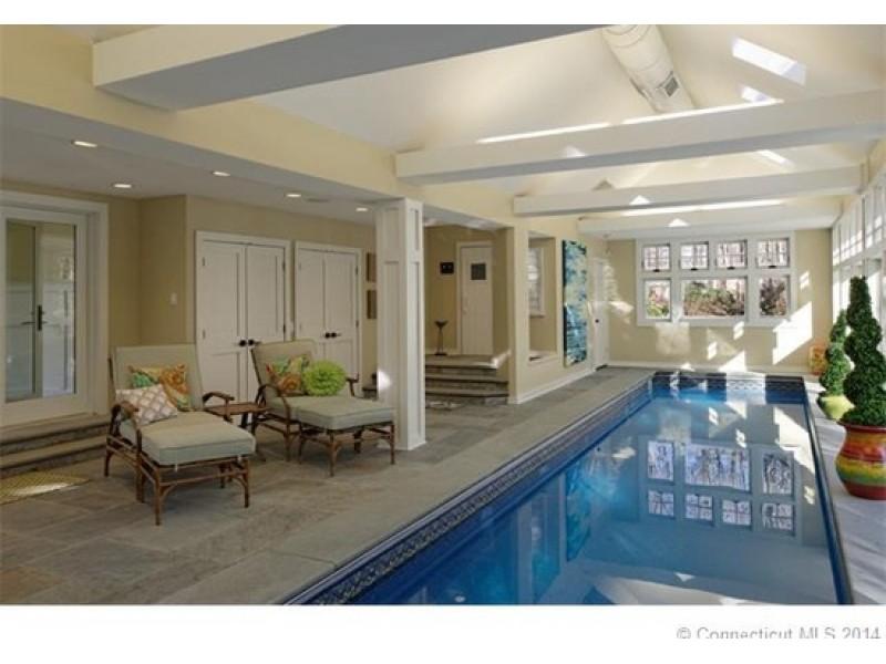 Woodbridge home heated indoor pool dramatic living room