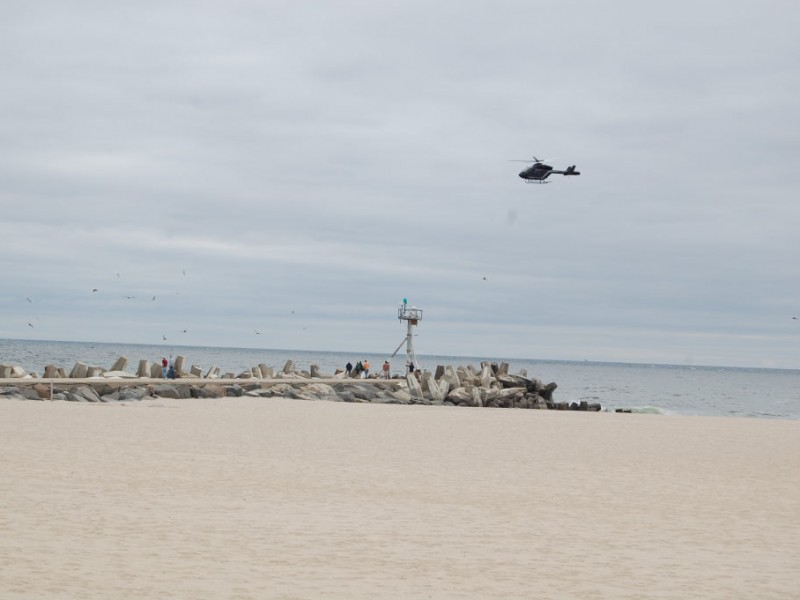 Three including brick man rescued from capsized boat in for Manasquan inlet fishing