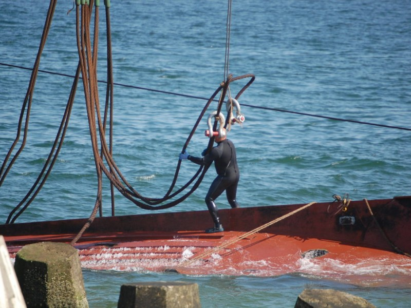 Capsized fishing vessel hoisted from ocean in point beach for Fishing boats point pleasant nj