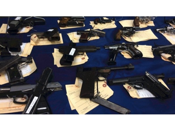 66 face drug, weapons, racketeering charges in gang sweep