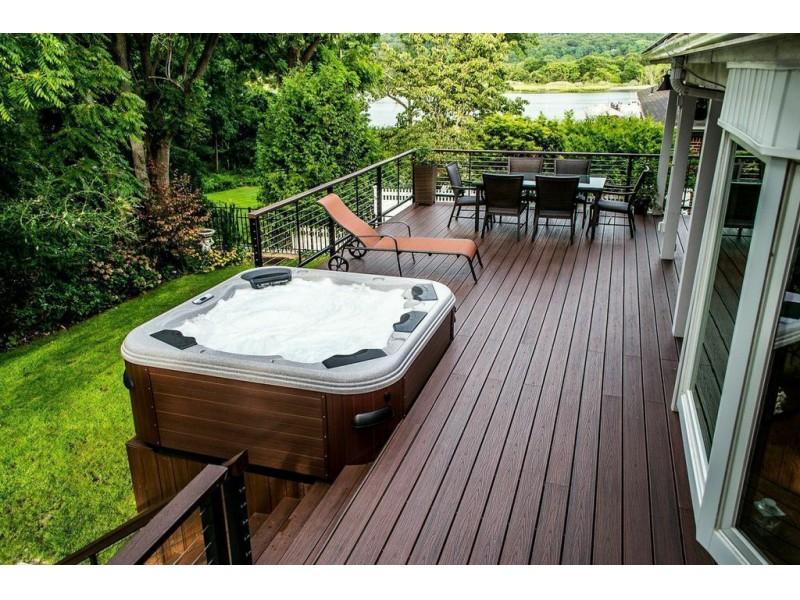 Outdoor enthusiasts get new deck and hot tub huntington for Garden decking with hot tub