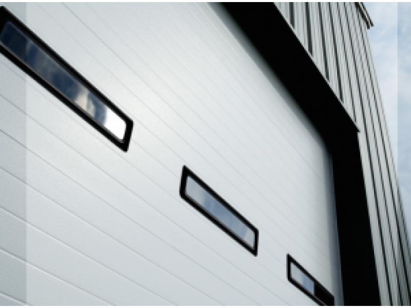 Bill 39 s overhead doors donated custom garage door for a local for Veteran garage door