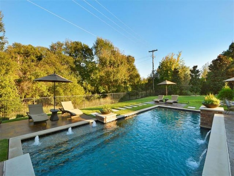 WOW: The Backyard Features with a Patio, Pool and Spa | Patch
