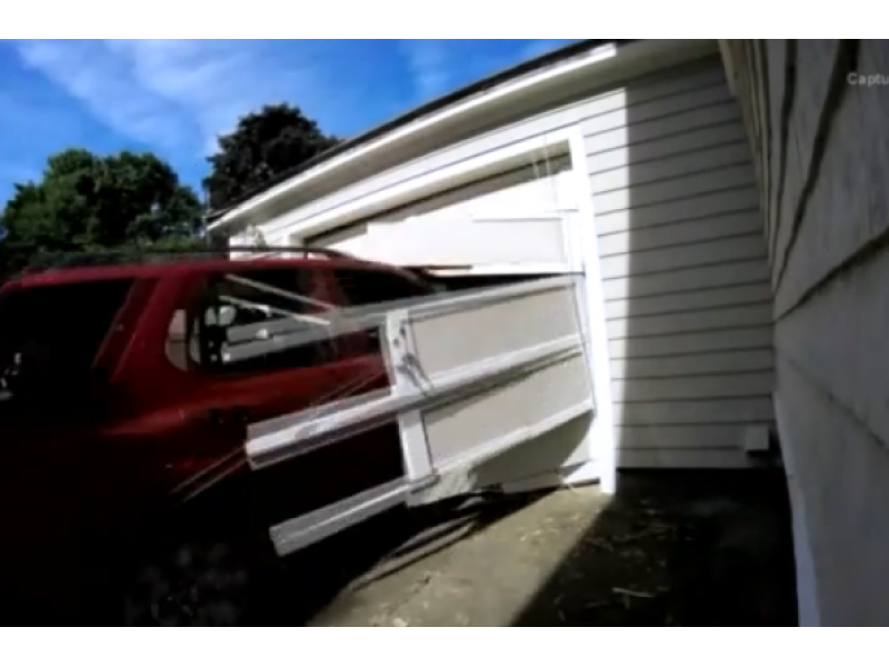 Man fulfills bucket list by driving through garage door for Drive through garage door