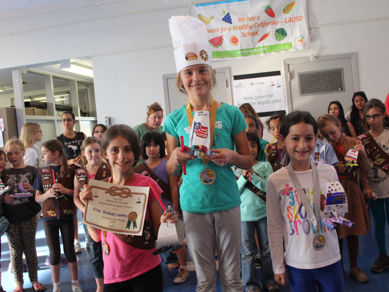 local girl scouts host raingutter regatta and cookie kick