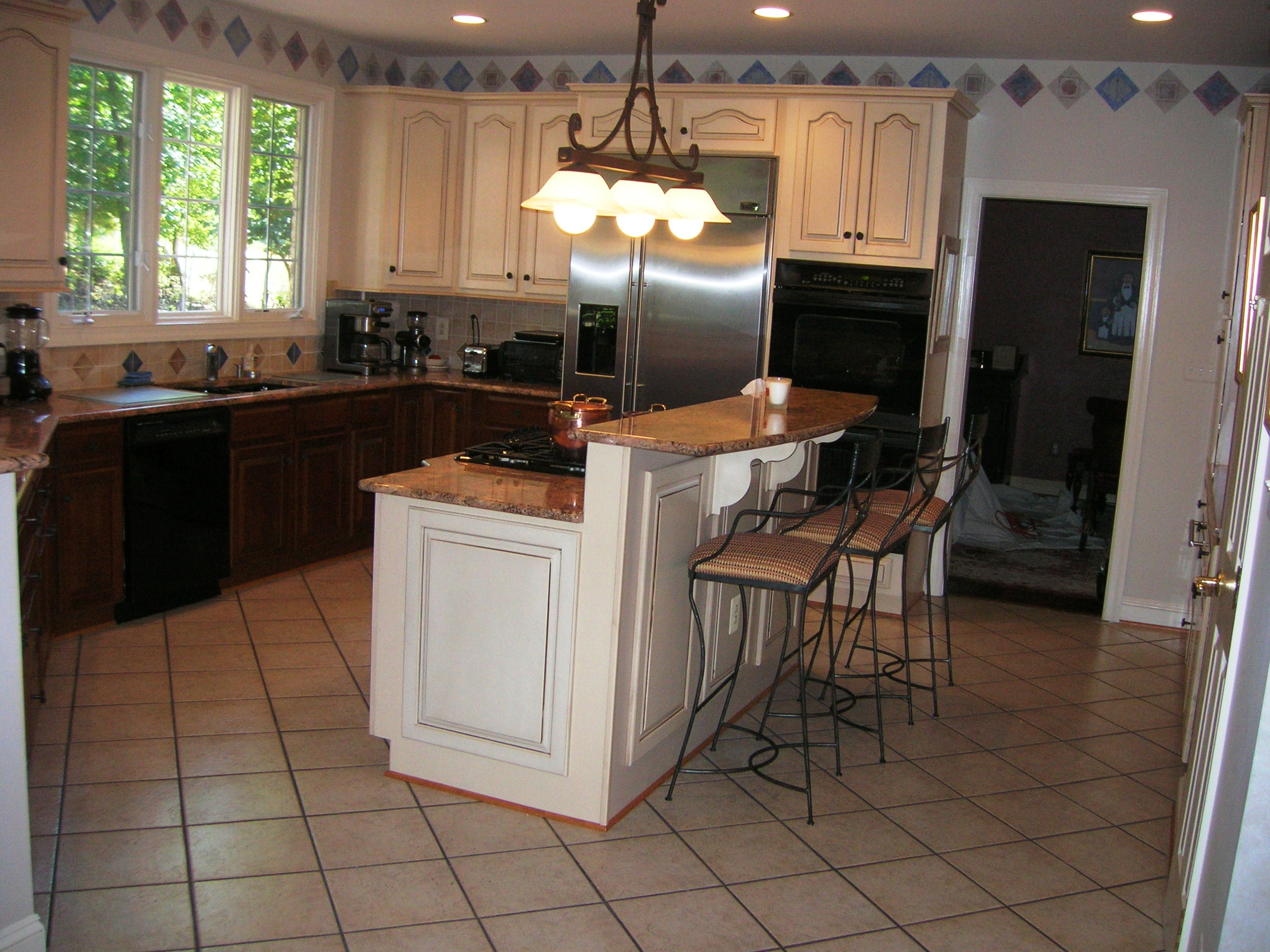 Finding the right flooring the pros and cons of high end for Kitchen flooring options pros and cons