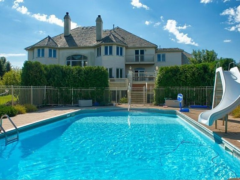 house wow two story windows overlook outdoor pool in