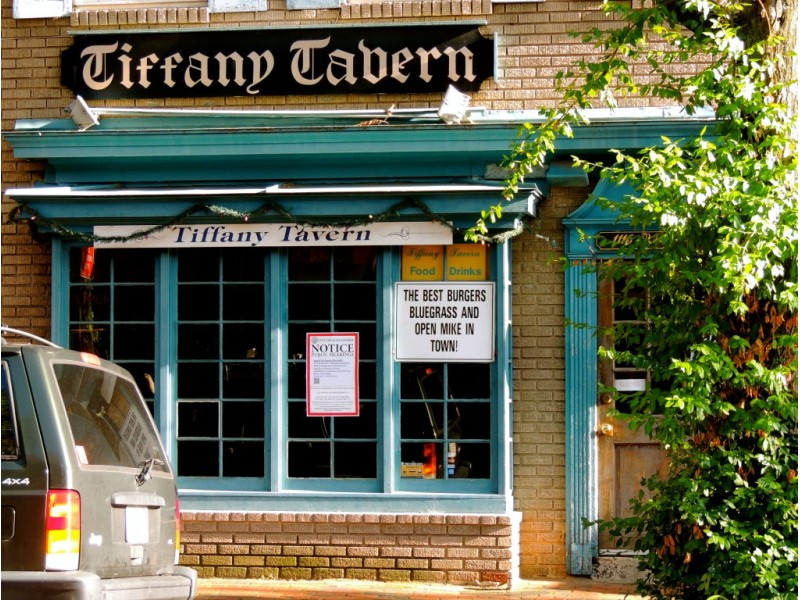 the tiffany tavern sign may soon come down from its perch above king