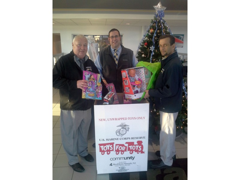 Tracy chevrolet cadillac holds 4th annual toys for tots for Tracy motors plymouth massachusetts