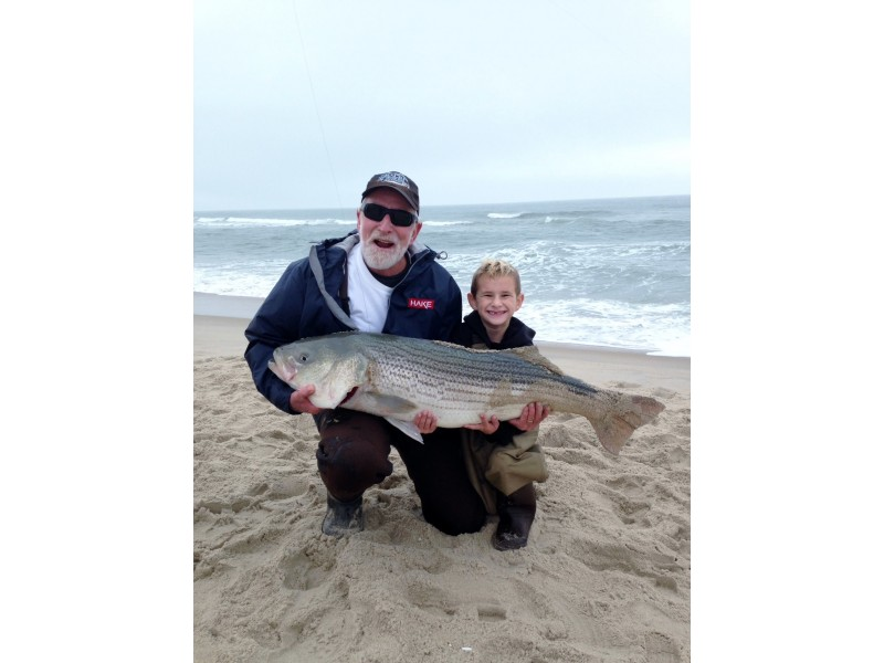 Watch 43 pound 6 year old catches 41 pound striper for Lbi surf fishing report