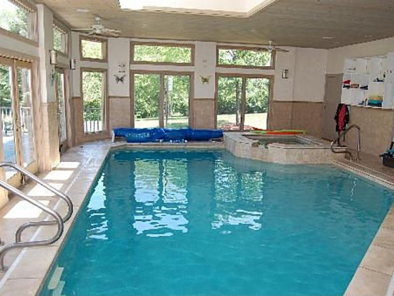 house wow glass encased indoor pool in sprawling ranch 0