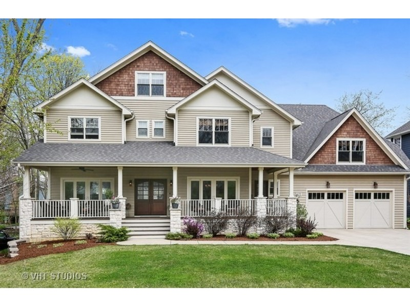 House wow home with four levels large front porch for Homes with large porches