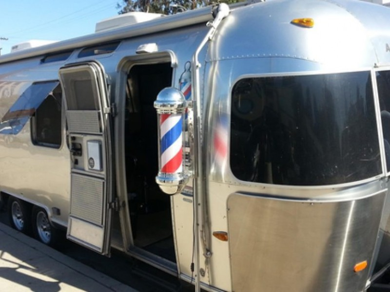 Lava Salon Owner Pushing Mobile Barber Shop Bill