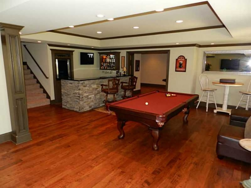 Home spotlight open floor plan finished basement 3 car for Home plans with basement garage