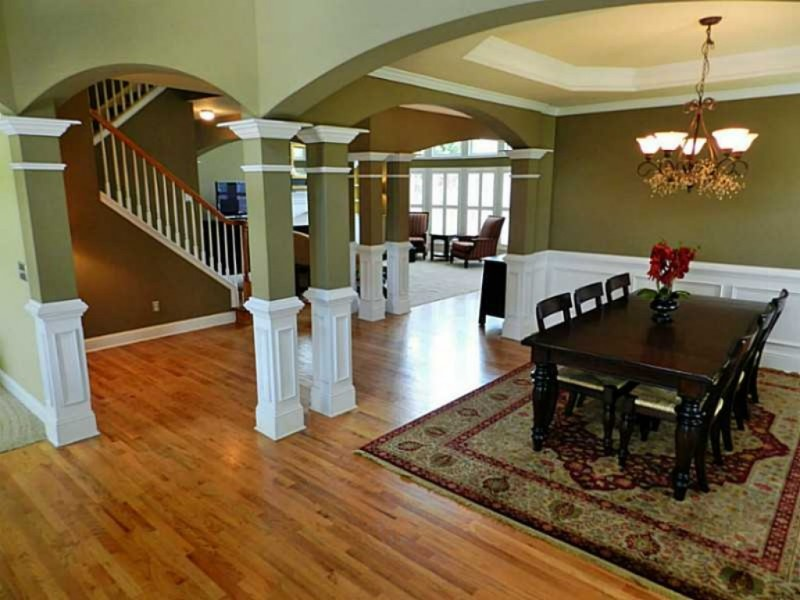 Home spotlight open floor plan finished basement 3 car for Log home floor plans with garage and basement