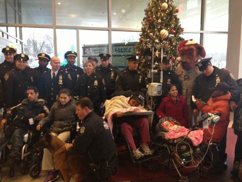 Photos: Police Bring Toys, Holiday Spirit to St. Mary's ...