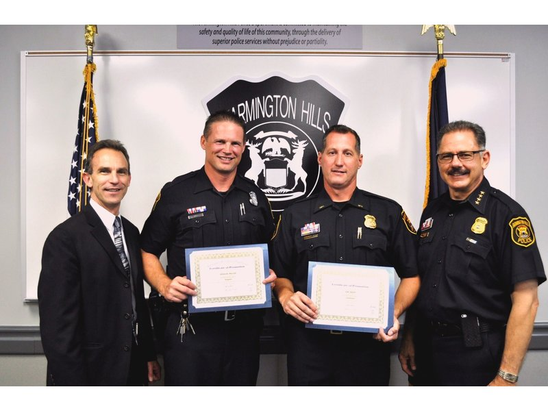 Two farmington hills police officers earn promotions for Royal family motors canton